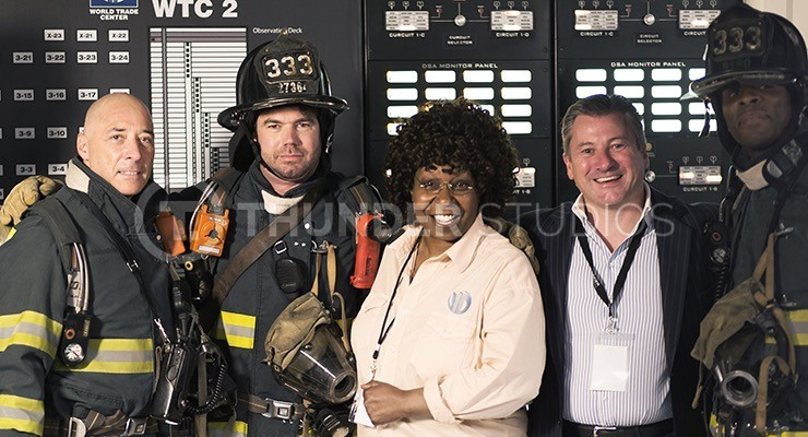 Rodric David and Whoopi Goldberg with casgt members portraying firefighters during filming Nine Eleven at Thunder Studios