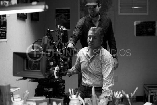 Rodric David in directors chair at Thunder Studios