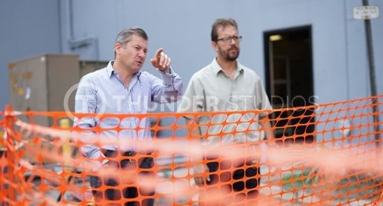 Rodric David conversation Richard Gray outside Thunder Studios during renovations