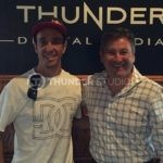 Rodric David and Robbie Maddison in front of Thunder logo