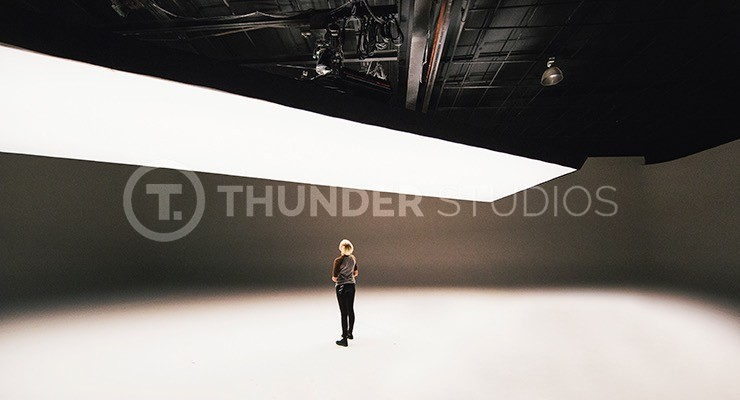 At-Rodric-Davids-Thunder-Studios-a-crew-member-stands-under-a-large-Fisher-light-for-Distribution-102-post