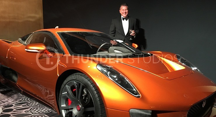 Rodric David stands with the James Bond Spectre Jaqguar X75 at the BAFTA awards dinner.