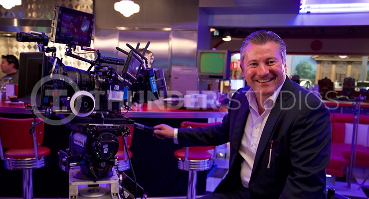 Behind the scenes on the set of Nine Eleven, in a New York Diner sits Rodric David with a film camera